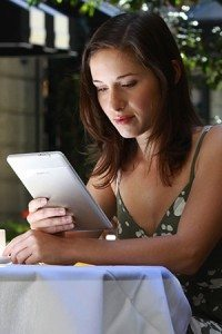 Woman reading Kindle